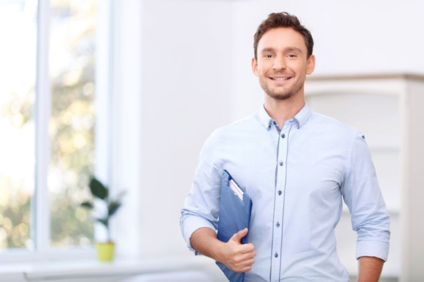 employee holding a file and smiling confidently