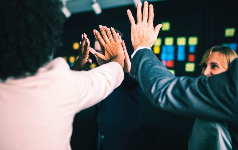 business team doing a high-five