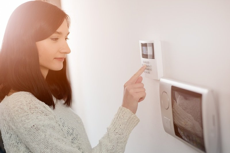 girl accessing home security